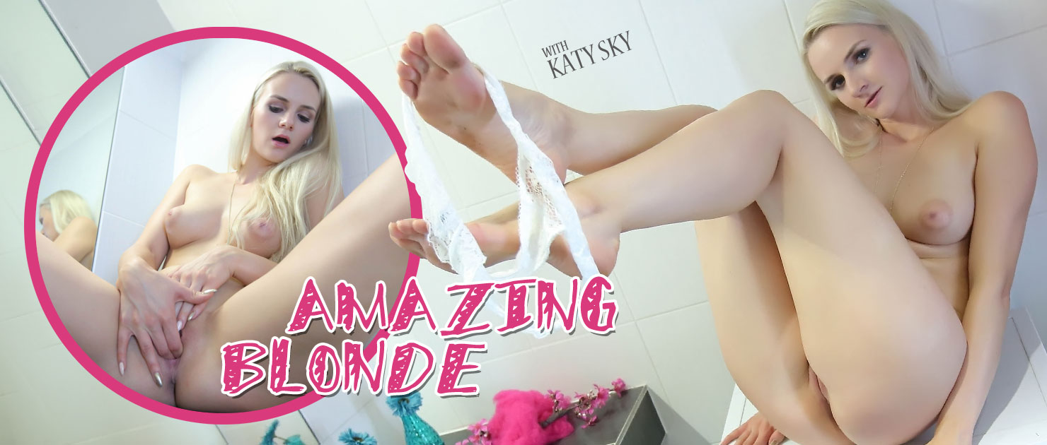 Blonde orgasms on bathroom sink