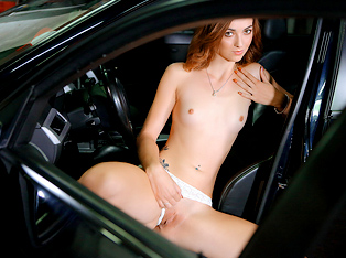 Cute Female Mechanic Plays Solo in the Car Service